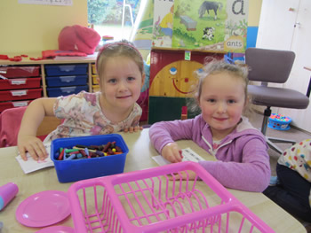 Girls playing with their crayons at St Aidans School Ballintrillick
