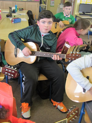 Pupil learning guitar at St. Aidans Ballintrillick