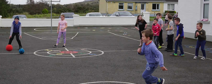 Children of St Aidan's NS playing dodgeball in the playground, Ballintrillick