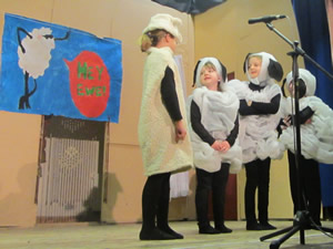 Pupils at St. Aidans acting as lambs in school play