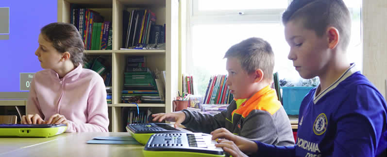 Pupils learning keyboard at St. Aidans Ballintrillick