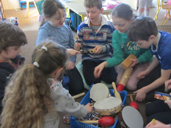 Children selecting musical instruments at St Aidans NS Ballintrillick