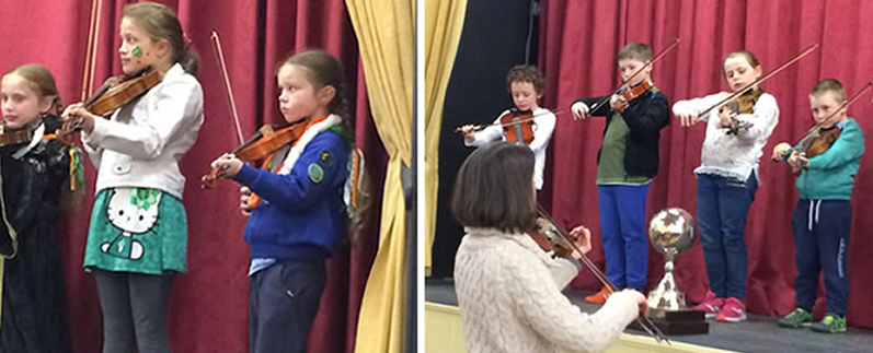 Children at St Aidans playing fiddle in Cliffoney hall