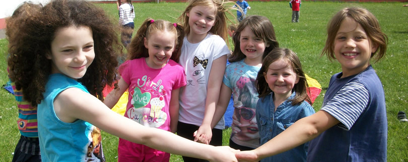 St Aidans Ballintrillick NS & some pupils enjoying themselves in garden