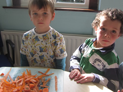 Kids at St Aidans NS Ballintrillick preparing carrots for their soup