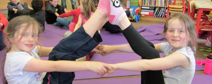 Children at St. Aidans practicing yoga
